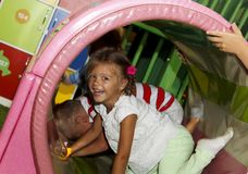 Children Playing And Having A Good Time In Kids Zone In Amusemen Stock Images