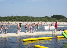 Children playing in aqua splash park Stock Image