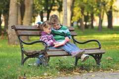 Children playing in autumn  park Royalty Free Stock Photo