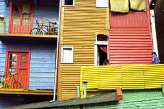 Children playing on balcony in colorful La Boca Royalty Free Stock Photos