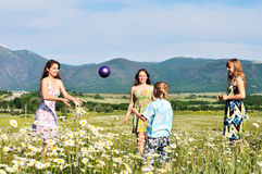 Children playing a ball in fiels Royalty Free Stock Photography