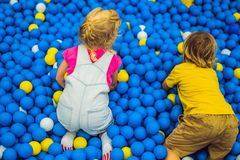 Children playing in ball pit. Colorful toys for kids. Kindergarten or preschool play room. Toddler kid at day care royalty free stock photo