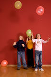 Children playing with ballons