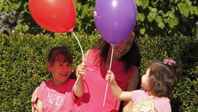 Children playing with balloons stock video footage
