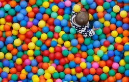 Children playing on a balls pool on a families activities event during local patron festivities in palma de mallorca. February 3, 2019. Children playing on a royalty free stock photos