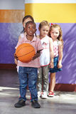 Children playing with basketball Stock Photo