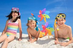 Children playing on beach Stock Image