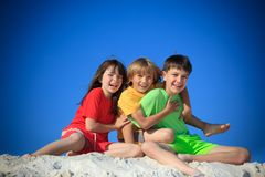 Children playing on beach stock photo