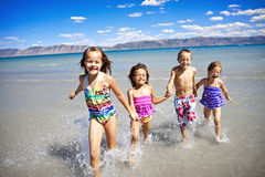 Children Playing at the Beach Royalty Free Stock Photos