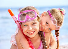 Children playing on  beach. Snorkeling Royalty Free Stock Photo