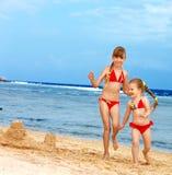 Children playing on beach. stock photos