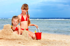 Children playing on  beach. Stock Photo