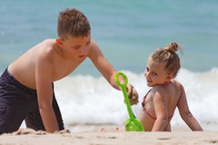 Children playing on the beach during Stock Photos
