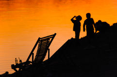 Children playing at beach. Children silhouette  playing at beach at sunset Royalty Free Stock Photos