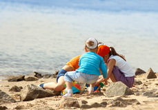 Children playing on the beach Stock Photo