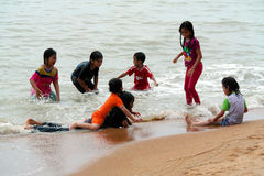 Children Playing On Beach Stock Photos