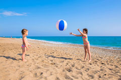 Children playing with beach ball outdoors. Summer vacation, family vacation concept Stock Photos