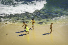 Children Playing at the Beach, California Royalty Free Stock Images