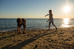 Children playing on the beach Stock Images