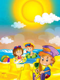 Children playing at the beach having fun by the sea or ocean Royalty Free Stock Images