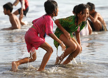 CHILDREN PLAYING AT THE BEACH IN INDONESIA Stock Images