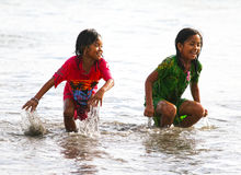 CHILDREN PLAYING AT THE BEACH IN INDONESIA Stock Photo
