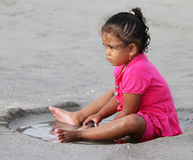 CHILDREN PLAYING AT THE BEACH IN INDONESIA Stock Photography