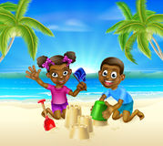 Children Playing on the Beach. Kids having fun building sandcastles on a tropical beach with palm trees Stock Photo