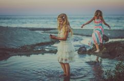 Children playing in the beach royalty free stock images