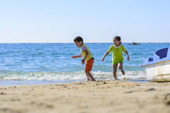 Children Playing at Beach Royalty Free Stock Image