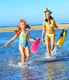 Children playing on  beach. Royalty Free Stock Photo