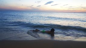 Children playing on the beach at sunset. sea, Travel and vacation concept, Summer time concept royalty free stock image