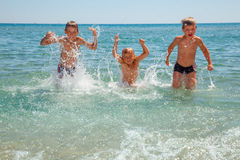 Children playing on a beach Royalty Free Stock Images