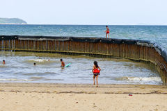 Children playing at the beach Stock Images
