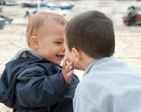 Children playing at beach Royalty Free Stock Photos