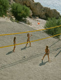 Children playing beach volleyball. Happy Twins sisters playing beach volleyball Stock Photo