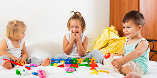 Children playing on  bed Stock Photos