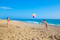 Children playing with a big ball on the beach. Summer vacation, family vacation concept Royalty Free Stock Photography