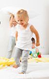 Children playing on  big bed. Royalty Free Stock Photos