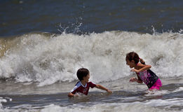 Children Playing in the Big Surf Royalty Free Stock Image