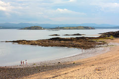 Children playing at the Black Sands Beach in Aberdour in Scotland Royalty Free Stock Image