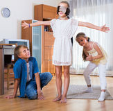 Children playing at Blind man bluff indoors. Laughing european children playing at Blind men bluff indoors Royalty Free Stock Photo
