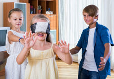 Children playing at Blind man bluff indoors Stock Photography