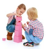Children playing with blocks. Royalty Free Stock Photography
