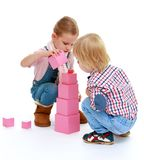 Children playing with blocks. Stock Photos