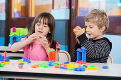Children Playing With Blocks In Classroom Stock Photos