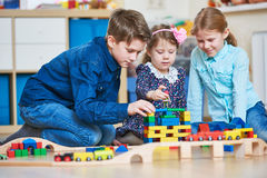Children playing with blocks indoors Royalty Free Stock Photo