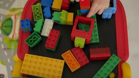 Children playing with blocks stock video