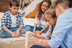 Children playing blocks wood game together at home Royalty Free Stock Images