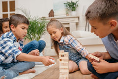 Children playing blocks wood game together at home Royalty Free Stock Image